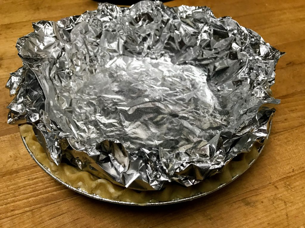 using foil in to blind bake a pie crust