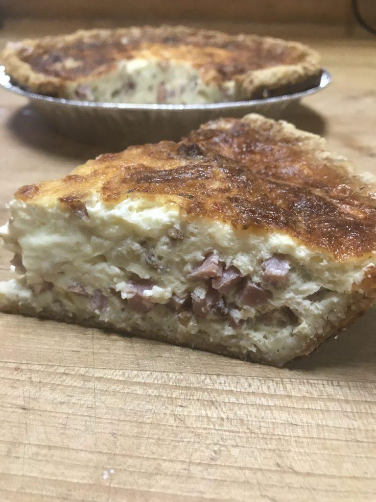 Slice of Quiche Lorraine using blind bake a pie crust